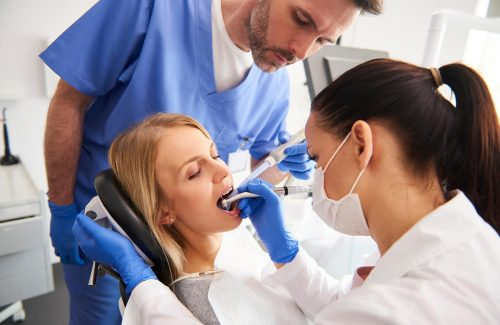 young-woman-is-getting-treatment-in-dentists-T8PLH8Y.jpg